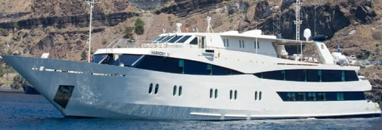 Harmony V anchored in Santorini Banner